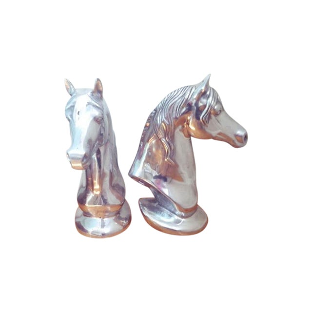 Amazing and heavy chrome horse head. Gorgeous polish! He's great on a shelf or as a centerpiece! Only one available.