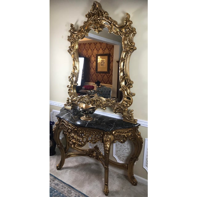 Reproduction of French Louis XV console, a matching set console and mirror with marble top. The mirror and the console are...