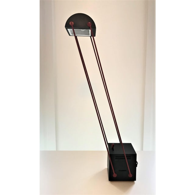 Adjustable desk Lamp by Japanese designer Asahara Shigeaki, for the Italian manufacturer Stilnovo in 1980. Dimmer is a...