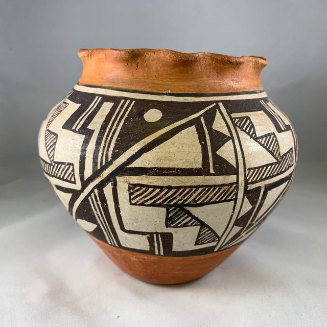 A thin walled and delicately decorated with an intricate geometric design Olla in the traditional style of the Acoma...