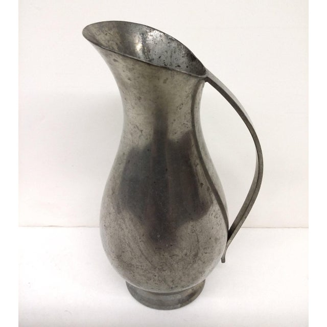 A very cool pitcher made in Holland. I have not polished it or even cleaned it beyond rinsing under water. Thought I would...