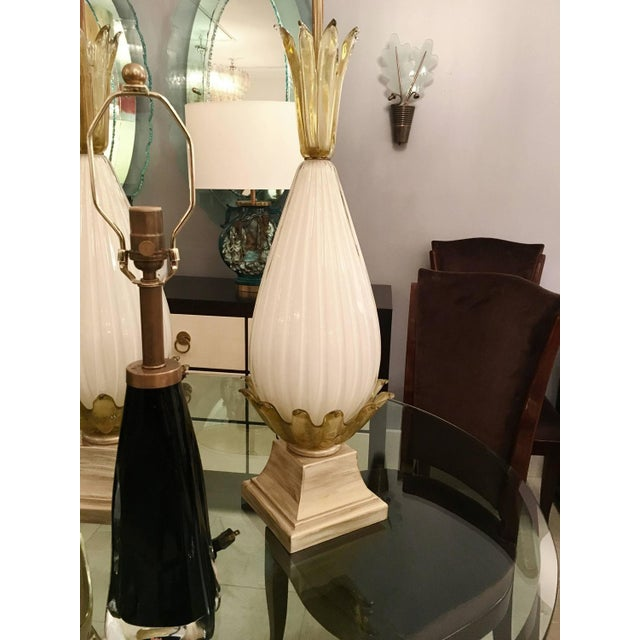 A pair of fluted glass lamps with botanical glass detail on wood bases with cerused painted finish. Italian, circa 1940's