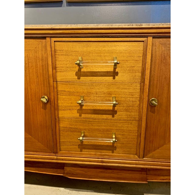 This is a wonderful example of a Moderne Enfilade or sideboard that dates to the 1950s. The Enfilade was crafted of Fine...