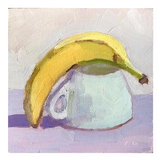 Banana over tea cup