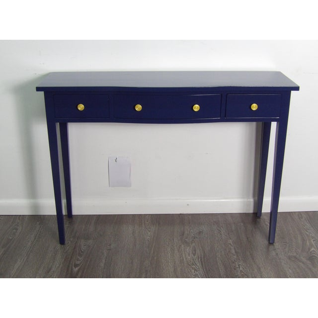 Crisp, Bold, and Clean Lines in Navy Blue is this reinvented and restored Console Table. The table has a new lacquer...