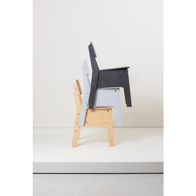 Plywood chair, available in many different colors.