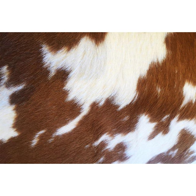 "Shown in Classic Caramel and Ivory Calf Hide Hair with matching caramel suede back. Measures 12""x 20"" Feather Fill Soft..."