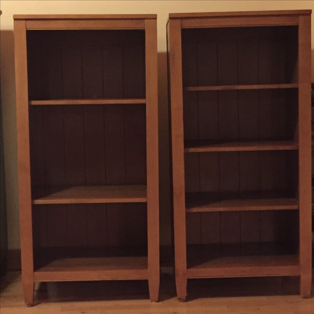 Set of two solid wood bookcases. One has 3 shelves, the other has 4. These can be used for books, pictures, stereo...