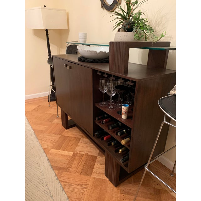 Fits glasses, bar ware and liquor in this mid century inspired bar.