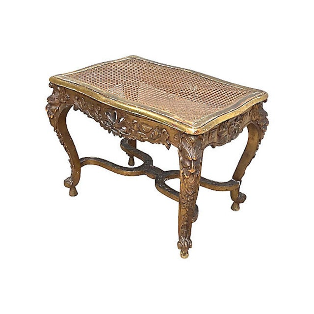Antique French caned and carved gargoyle gilt bench with hand-carved cabriole legs adorned with gargoyle faces. Seat is...