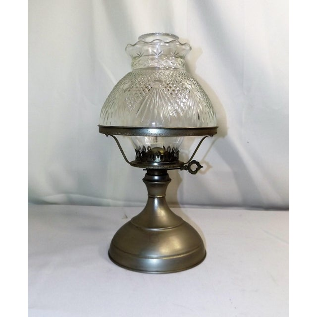 Here is a beautiful old Kaadan Ltd. Oil Lamp with a pressed glass shade that looks like cut glass. I believe the base is...