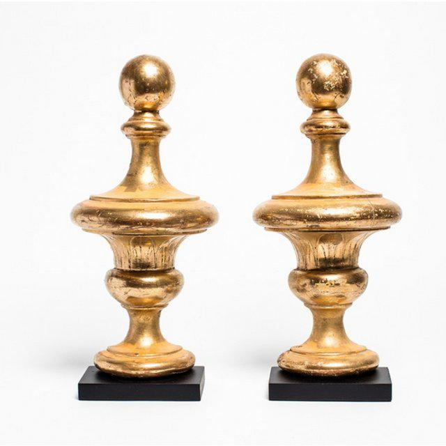 Pair of antique wood carved gilded vases, circa 1850. Mounted on a black base. Very fresh, modern shape in antique condition.