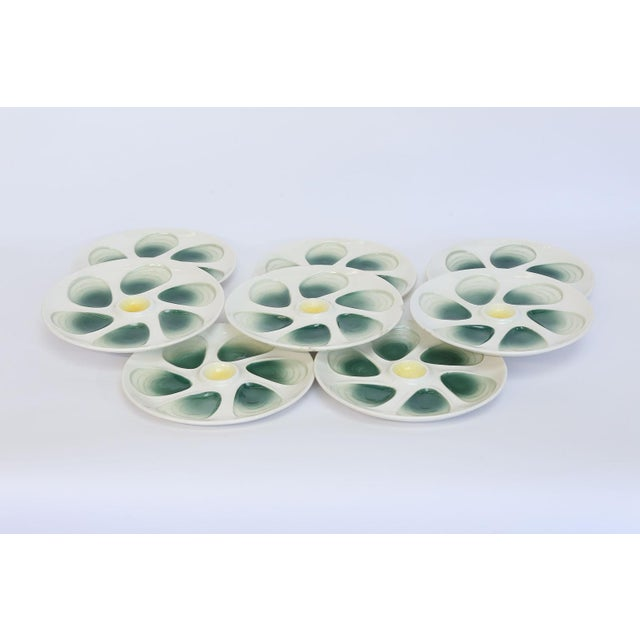 This is a set of eight French oyster plates made by and marked Salins France. The Salins faience factory was established...