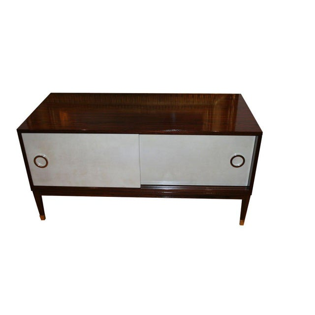 Rosewood console with natural parchment sliding doors detailed with nickel ring hardware and sabots. Sabots shown not...