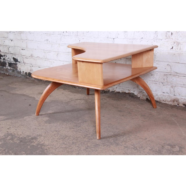 A stunning mid-century modern maple two-tier corner side table By Heywood-Wakefield USA, 1950s Solid maple construction...