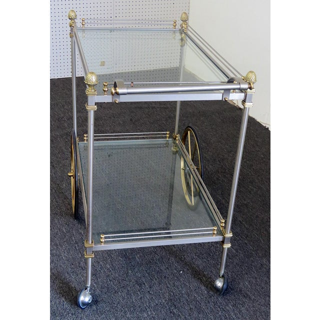 Regency style chrome bar cart with 2 glass inserts and bronze accents.
