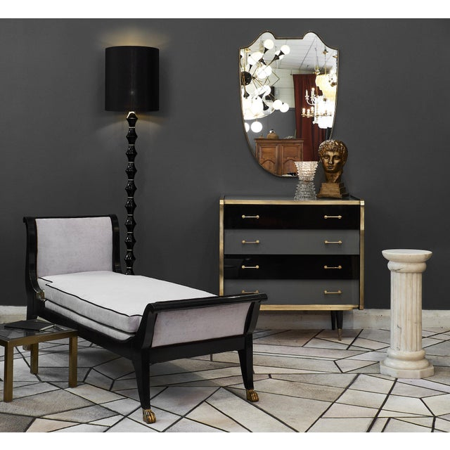 A refined Italian vintage glass covered chest of drawers in two tones of glass, black and gray. The piece has four...