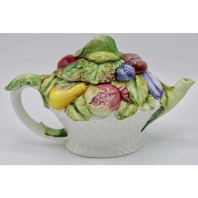 A charming Italian teapot by Nove, circa 1970. Bright colored fruit adorns this lovely vessel; including lemons, grapes,...