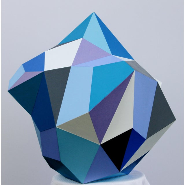 This is a beautiful diamond shaped abstract sculpture. It is unique in the sense that it looks like a painting as well.
