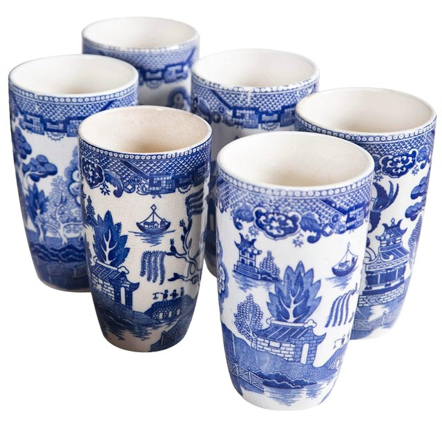 Vintage collection of blue and white Willow. The set includes multiple sets of salt & pepper shakers, cups & saucers,...