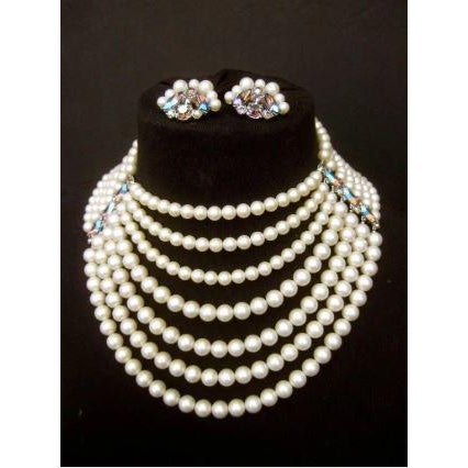 Schiaparelli dramatic multi strand faux pearl necklace dating from the 1960s. This high impact graduated seven strand...
