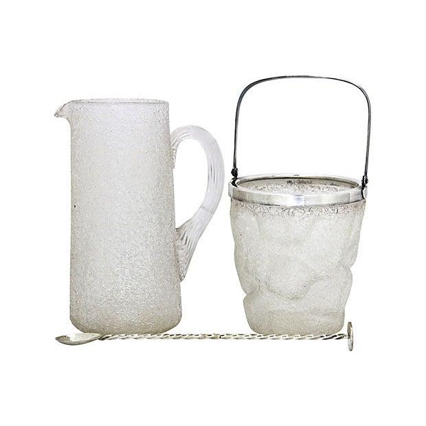 "1920s English ""crackle glass"" beverage set. Dimensions: pitcher, 6.5""L x 4.25""W x 8.5""H; ice bucket, 5.25""Dia x 5.5""H,..."
