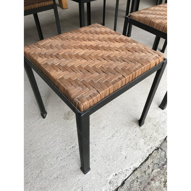 Danny Ho Fong wrought iron and reed dining table and six stools for Tropi-Cal. Dining table is all original, with original...