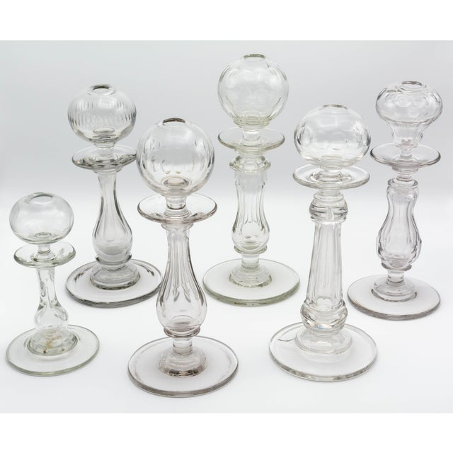 A set of six French Provençal glass oil lamps, often called lampe de dentellière, or lacemaker's lamps. Each with a hand-...