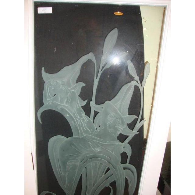 Pair of rare of fine etched glass doors or wall decorations. Each having a pair of woman in hats that seem to be in the...