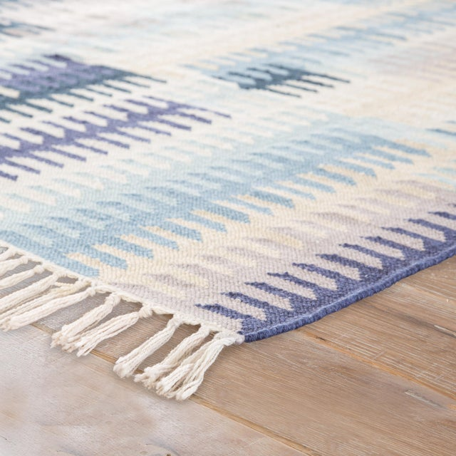 A geometric Southwestern design makes a boldly modern statement on the Desert Carver area rug. Constructed of weather-...