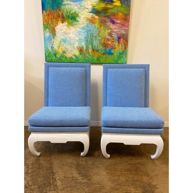 Freshly upholstered in blue and bases have just been lacquered in white. These are stunning. There are 2 pairs available...