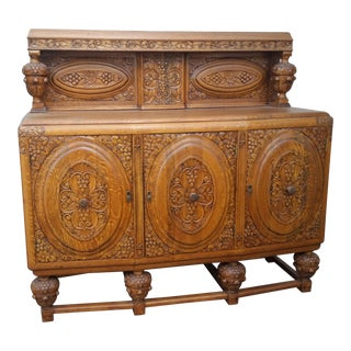 1920s Jacobean Tiger Oak Carved Grapes & Flowers Sideboard For Sale