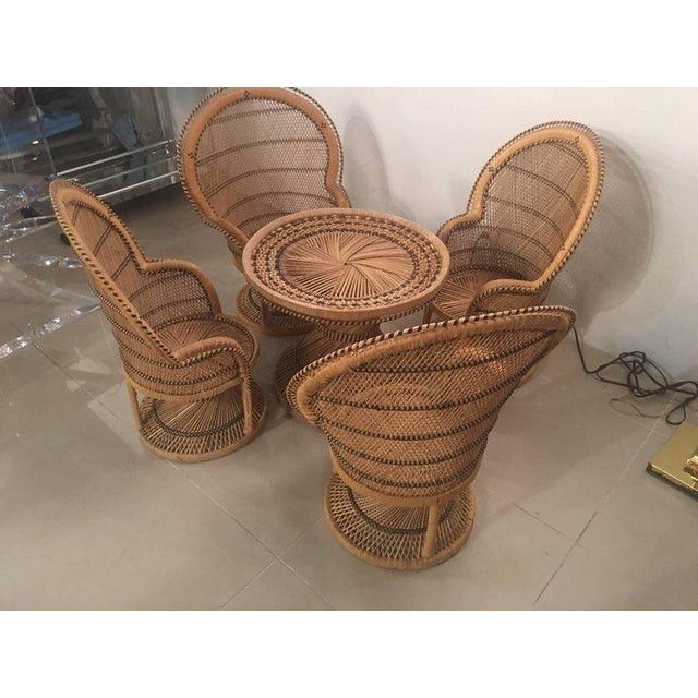 Such an amazing, one of a kind, vintage children's, kids Rattan and wicker dining set. Includes four Rattan peacock, fan...