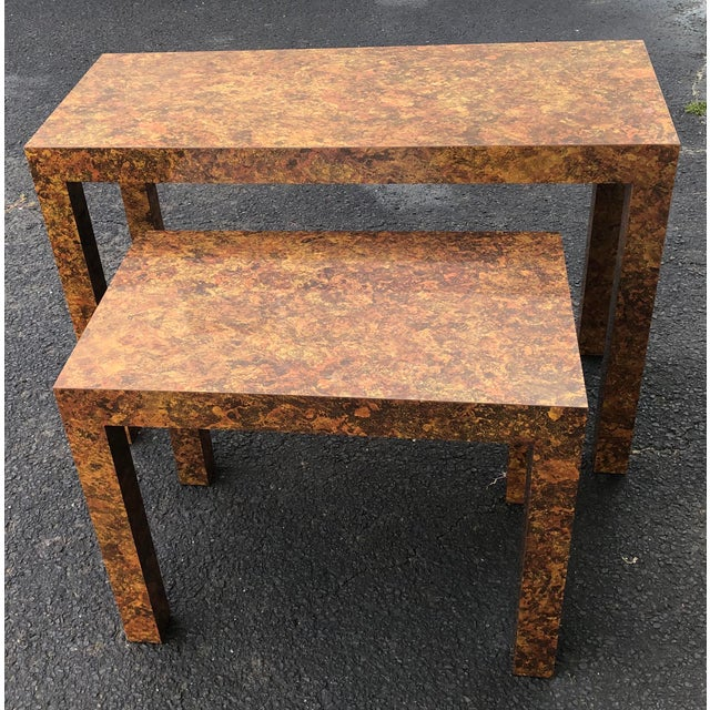 Unique set of Milo Baughman-inspired nesting parsons style console tables. Clean lines and timeless faux burl wood...