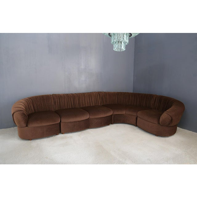 70's modular sofa complete with armchair. The sofa has 5 blocks including 1 corner. The sofa can hold 6 people. Original...