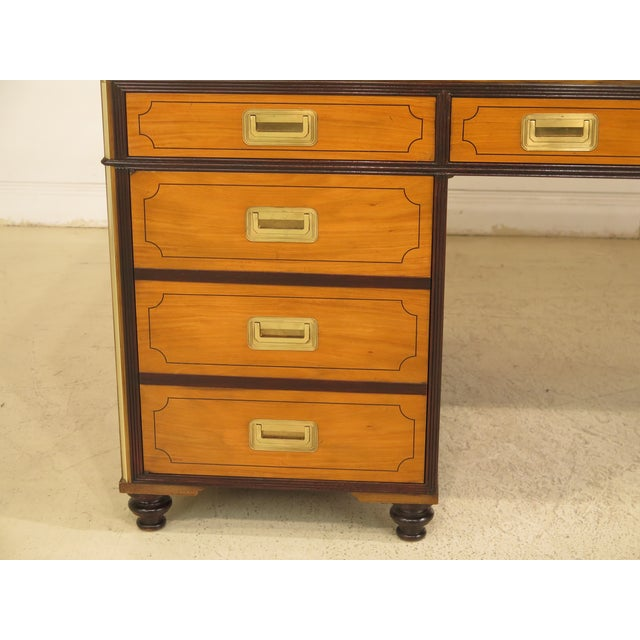 Baker Satinwood large leather top executive partners' desk. Approx. 40 years old. Dovetailed drawer construction. High...