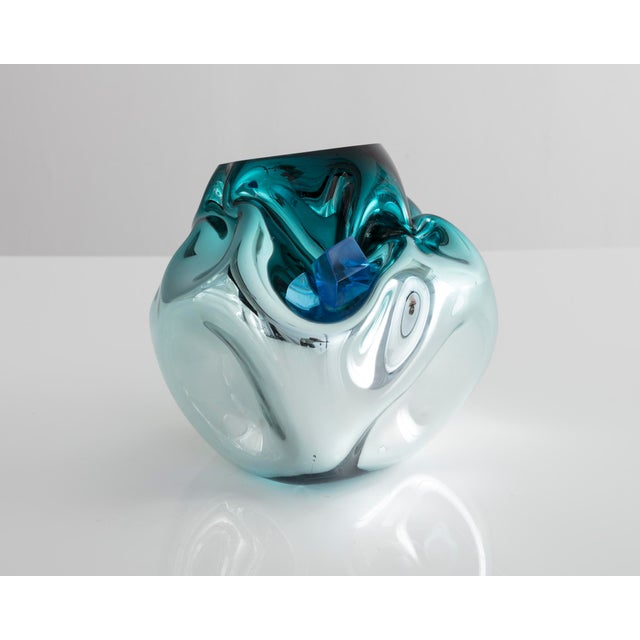 Unique petite crumpled sculptural vessel in silver and turquoise mirrorized hand-blown glass with applied glass crystal....