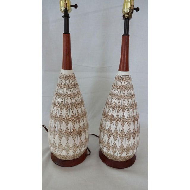 Great pair of Mid-Century Textured Diamond pattern Plaster and Teak Lamps. Smooth ivory and textured diamonds with a dark...