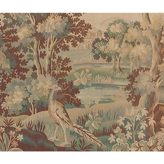 A graceful verdure tapestry in the style of those woven in the 18th century at Aubusson; one of the chief tapestry weaving...
