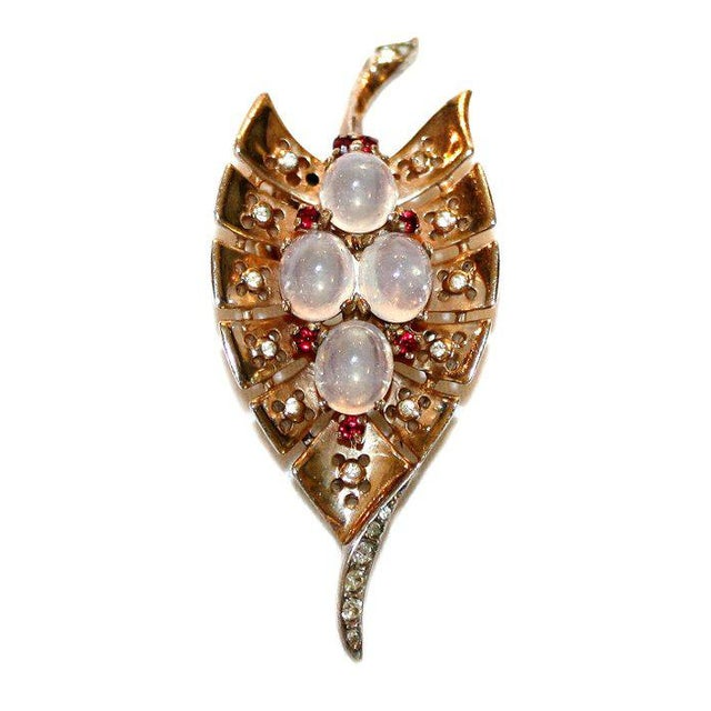 Lovely c.1930/40's signed Trifari gold-plated sterling fur clip in a leaf design, prong set with oval opaline glass...