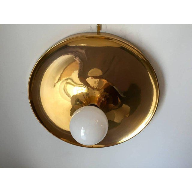 A large gold-plated brass German Space Age flush ceiling light. Rewired. Standard base bulb. Made by Honsel Leuchten.