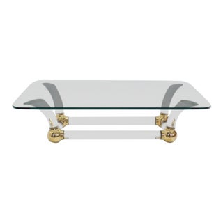 Hollywood Regency Lucite and Brass Base Thick Glass Top Coffee Table For Sale