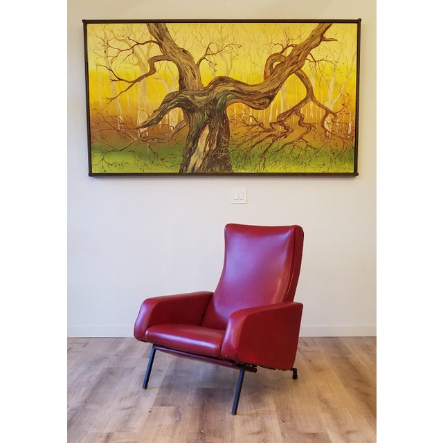 This vintage red reclining lounge chair is styled after Pierre Guariche's 'Trelax'. Having the capability to recline to an...