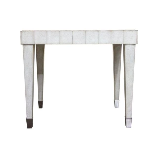 Features tapered leg, nickel ferrules, scalloped apron, hand applied glazed painted in a Pearl finish.