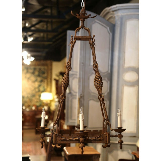 Decorate a breakfast nook with this rustic wrought iron light fixture. Forged in France circa 1850, the elegant Gothic...