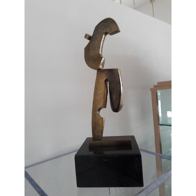 Large Italian bronze sculpture signed by artist Delo. The piece retains all original markings. The abstract form of a man...