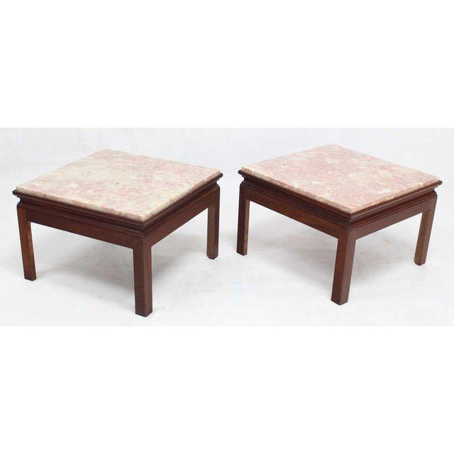 Pair of mid century modern style end tables stands with marble tops.