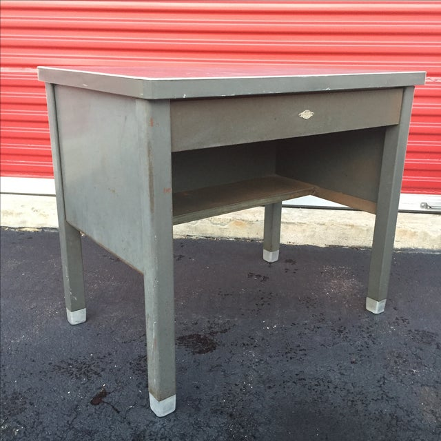 This Industrial Age desk by Art Steel of New York features solid steel construction, rubberized top and compartmentalized...
