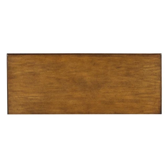 A rectangular molded top is veneered with rich prima vera placed over four stylized bamboo legs accented by leather bound...