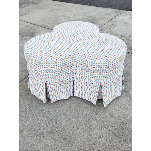 A fun contemporary geometric upholstery for a very classical clover form ottoman. A very nice center piece for a living...